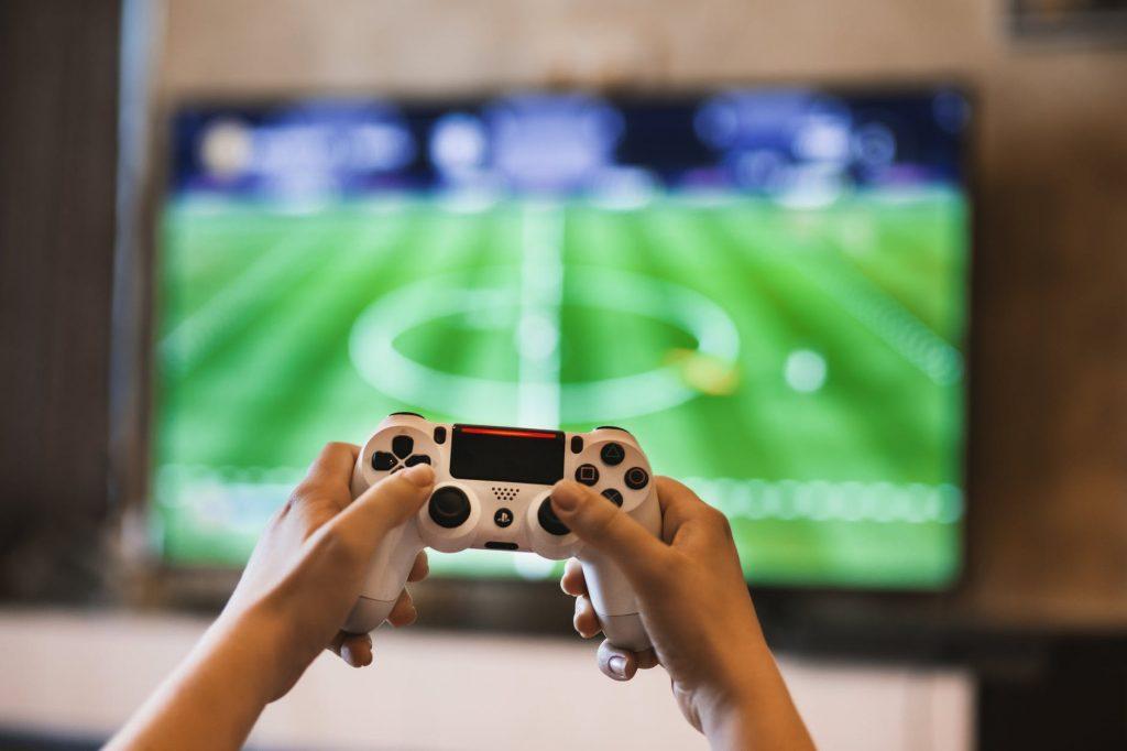joystick player playing fifa playstation